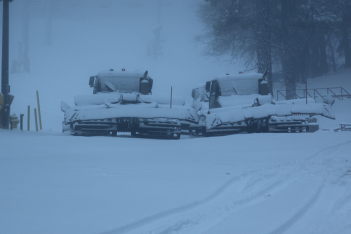 Snow cats waiting to hit the mountain.