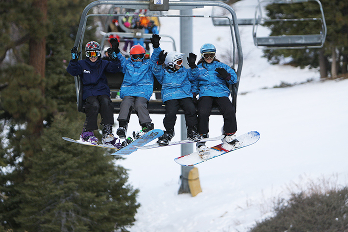 Members of Team Mountain High spend a happy Christmas Eve on the slopes.