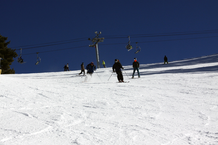 Skiers getting some turns in on one of many great runs.