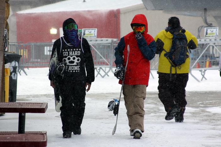 Walking across the snowy deck.