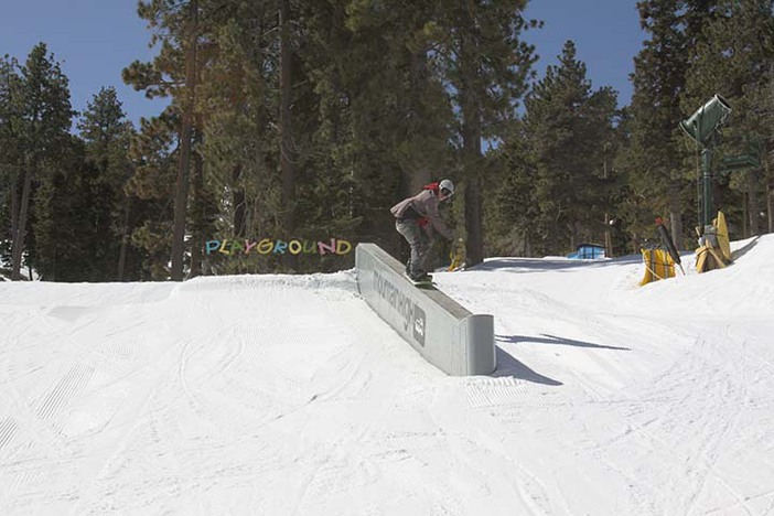 Lance hitting the concrete ledge on a sunny day.