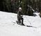 Telemark skiing and enjoying a beautiful day.