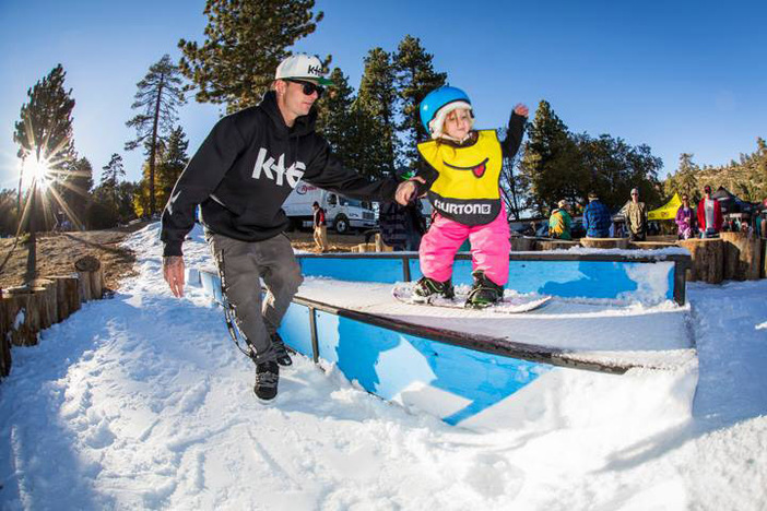 Cory Cronk teaching his daughter how to shred during the Learn to ride demo.