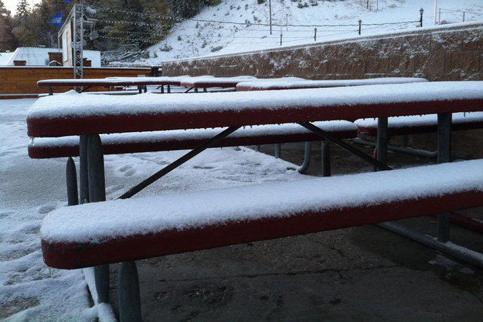 Light snow covers the sundeck.