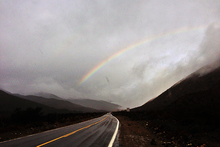 Rainy rainbow over Lone Pine Canyon Road.