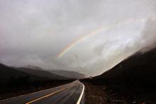 Rainy rainbow over Lone Pine Canyon Road.