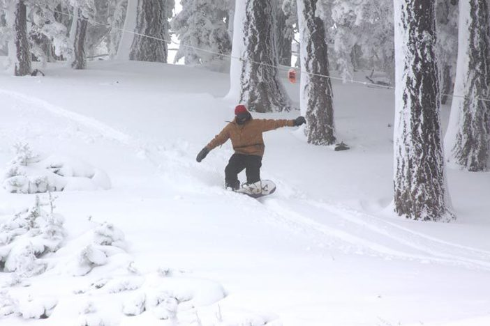 Snagging some fresh pow on the side of Upper Chisolm.