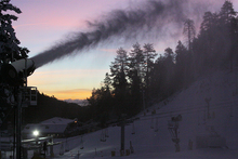 Blasting out snow as the sun lights up the horizon