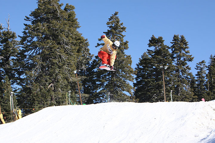 Catching some air on Lower Chisolm.