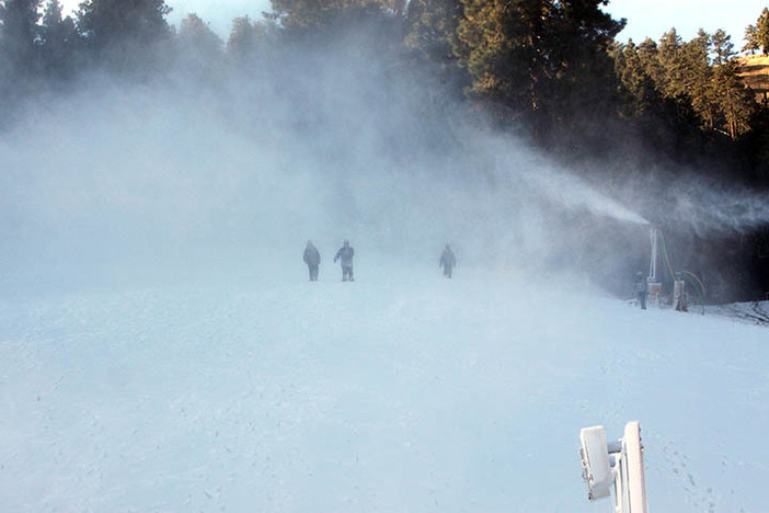 Snowmakers braving the frozen tundra.