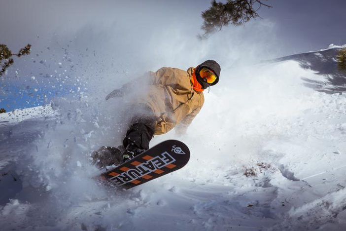 Todd Proffit blasting through the powder.