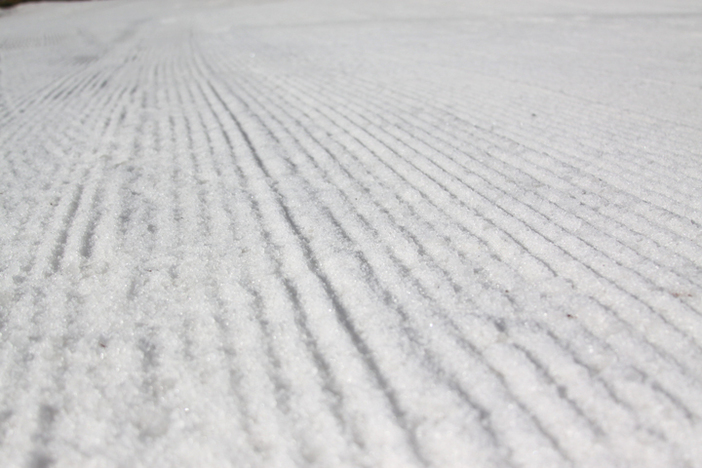 Freshly groomed corduroy on all open slopes.