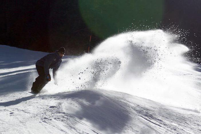 Proffit laying down a fat slash in the fresh made snow.