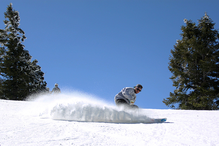 Carving up that packed powder.