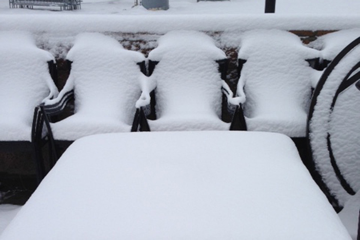 Chairs stacked and covered.