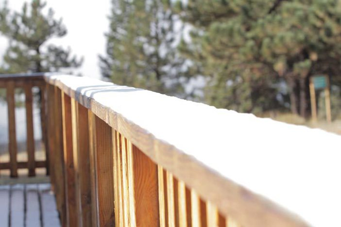 Snow lines the railing of the Grand View Bistro.