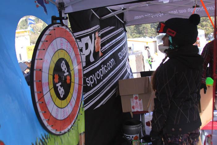 Taking her turn spinning the Spy Optics prize wheel.