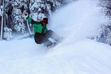 Slashing through the fresh snow.