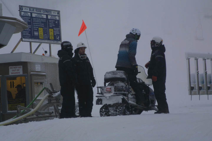 The snowmaking crew gearing up for their next run.