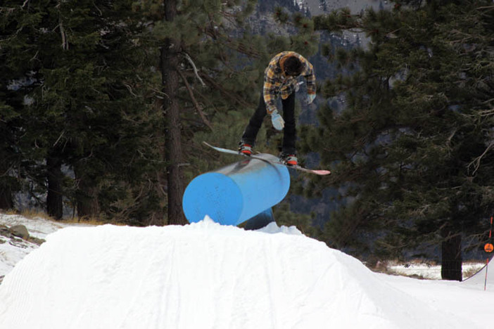 Brett Oftedal from Team Arbor shows off a sweet frontside boardslide on the Trojan Horse!
