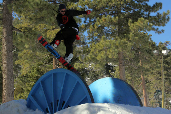 Trever Haas sliding the Spool Of Hard Knocks, now on Creekside.