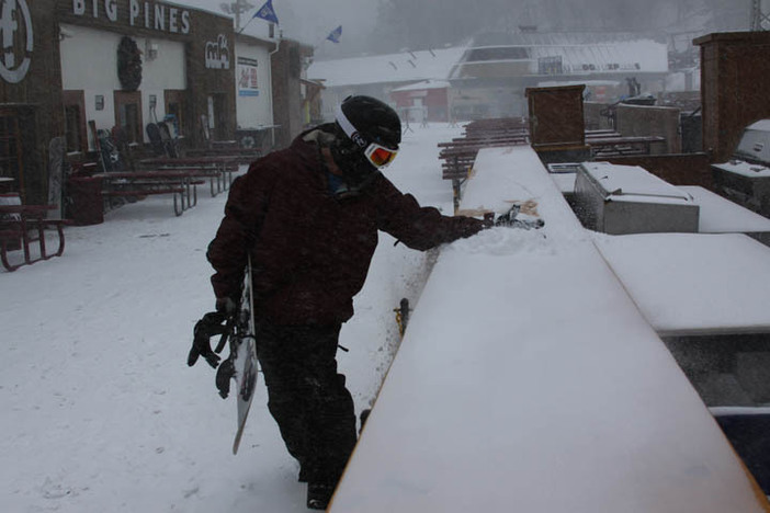 Sweeping the fresh snow off the Big Pines BBQ.