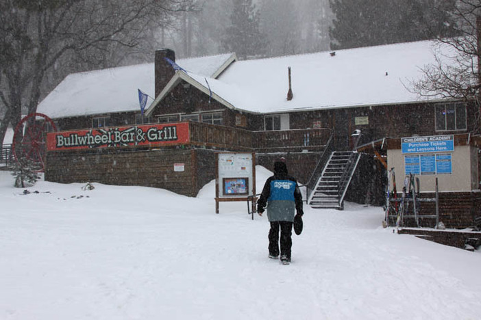 Fresh snow covers the Bullwheel Bar & Grill.