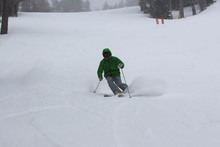 John Mccolly taking a few powder turns.
