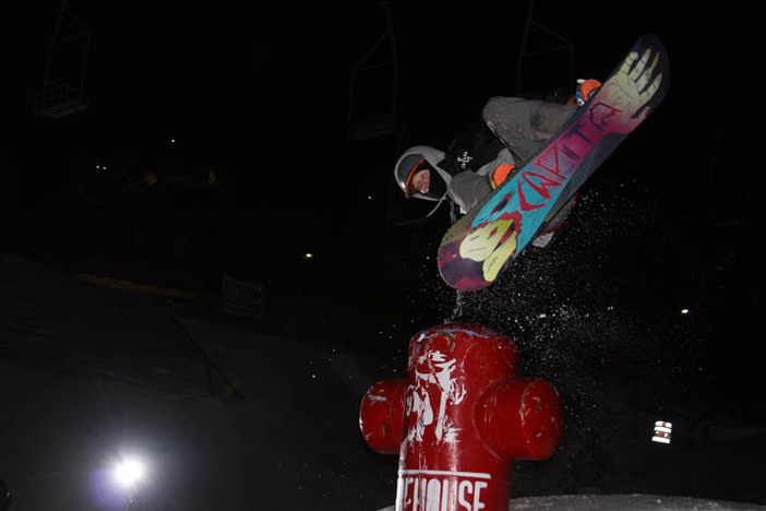 Planing a hand on the fire hydrant during last night's Shred Circuit rail jam.