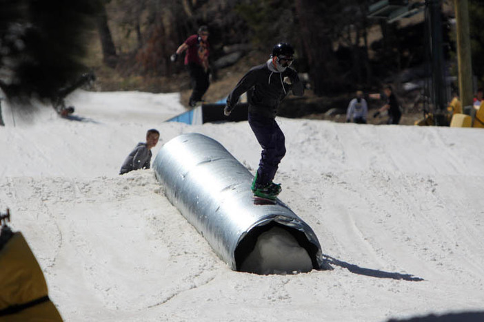 Sliding down the corrugated tube on Creekside.