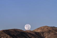 Super Moon peeking over the ridge.