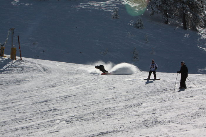 Carving through the packed powder on Lower Chisolm.