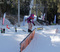 Young, female shredder getting a Tail Press during the USASA Rail Jam.