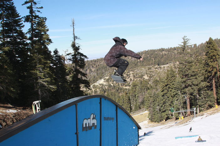 Launching off the Rainbow Rail on Lower Chisolm.