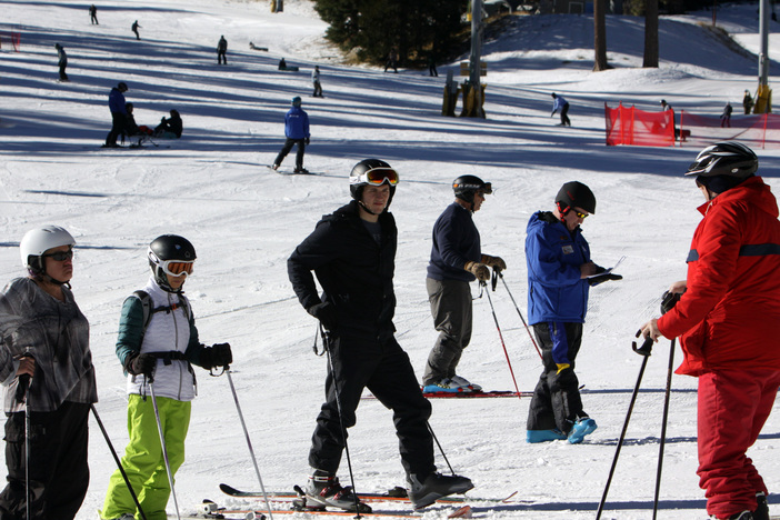 Getting some valuable tips from their winter Sports school instructor.