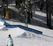 Ski slide on the flat down round rail.