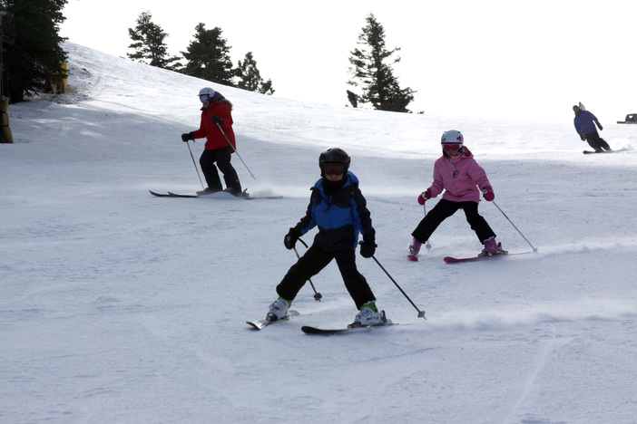 Skiing through the soft snow on Lower Chisolm