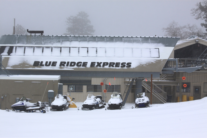 Fresh snow blankets the base of the Blue Ridge Express.
