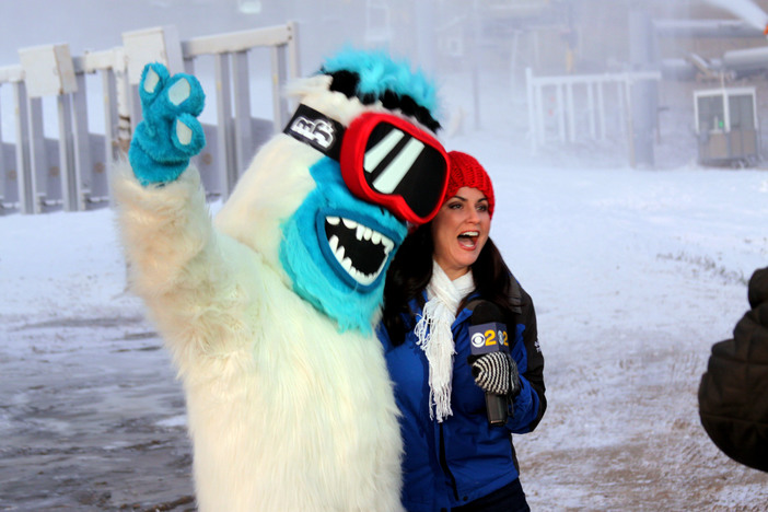 Joy Benedict from Ch 2/9 and the Yeti excited about the new snow.