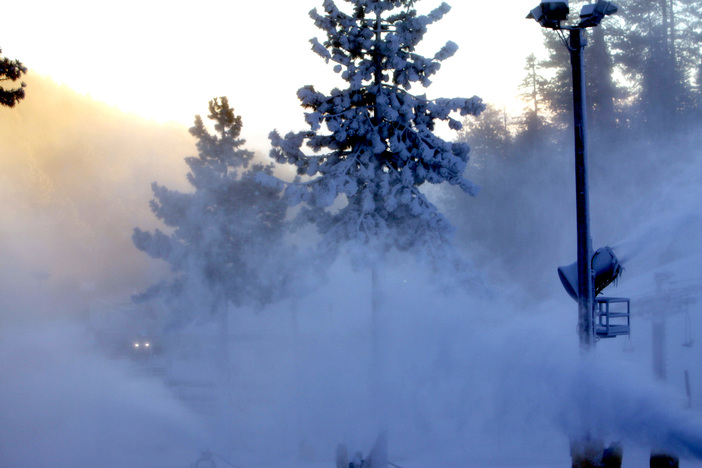 Early morning sun peaking through the snowmaking.